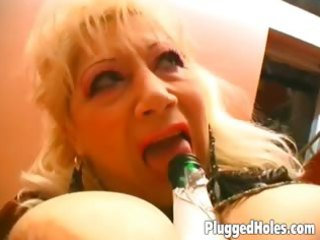 breasty mother i rides a bottle like crazy