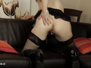 european older mommy playing with her sextoy on