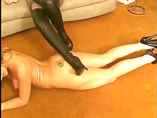 lesbian receives naked and licks high heeled boots