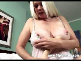 golden-haired horny grandma in teasing solo