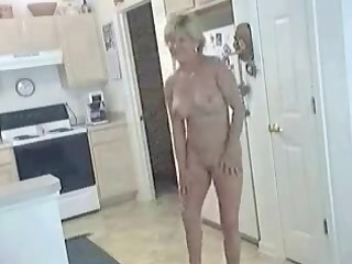 older hot mommy in natures garb in kitchen