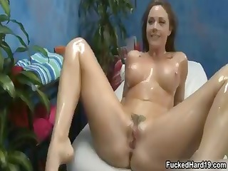 busty brunette chick is all oiled up and sucks