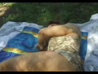 dark brown wife is taking a nap outdoors gets