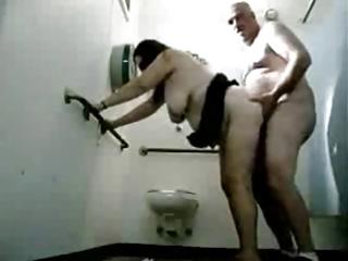 chap copulates a granny in public toilets