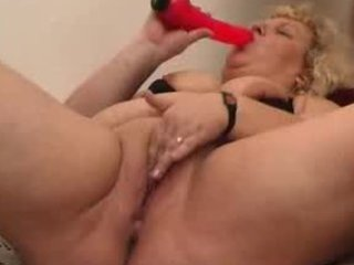 unsightly overweight granny wench playing with