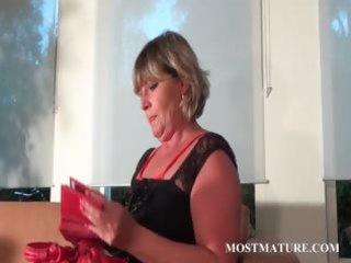 golden-haired mommy shows sexy mature body