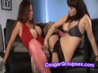 lewd dark brown cougar and redhead milf fuck a