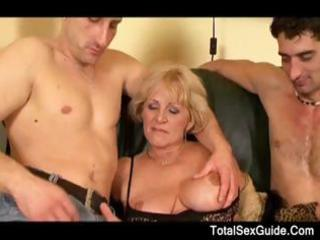 Granny in boots with big boobs gets a dick duo to
