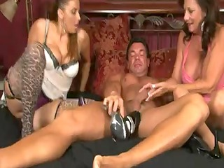 2 aged hotties give a stockings footjob