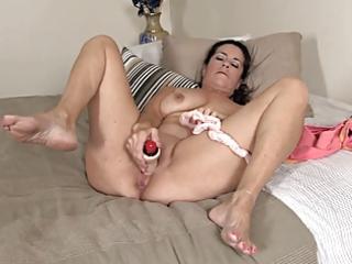 old mamma masturbates, using her pants