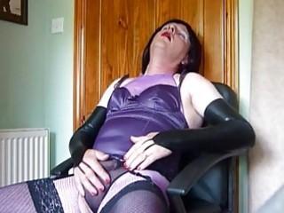 mature crossdresser in purple lingerie masturbates