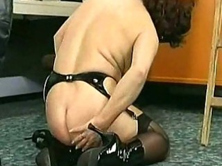 Masked milf slave crawling over the floor and