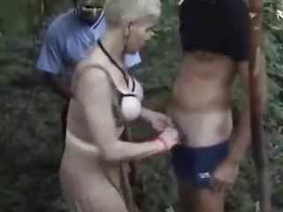 Horny wife has fun wuth voyeurs in forest.