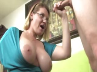 breasty mature with glasses milking a lizard on