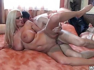 heavy chested aged blonde in nylons receives hard