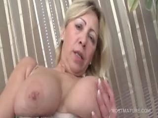 Mature tramp in stockings pleasuring pussy