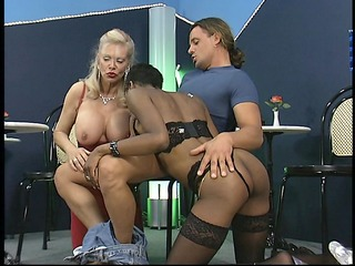 Mature stripper helps sucks young studs cock