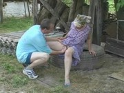 granny fucks anal in the garden with the postman