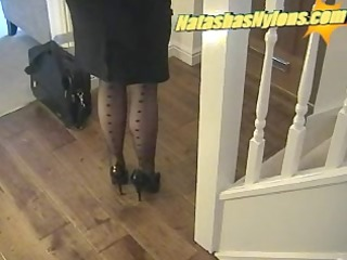 business boss with large scones in black nylons