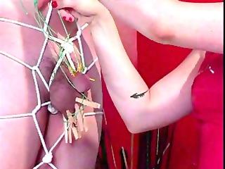 latex clad floozy in bondage act with a boy