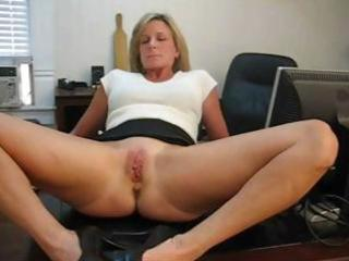 mature blond secretary spreads her legs and