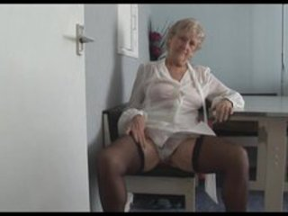 attractive granny in short petticoat undresses