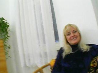 older blonde is having fun in the living room