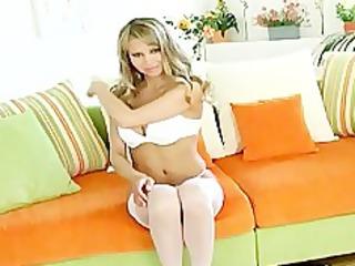 Blonde teases in stockings panties and heels
