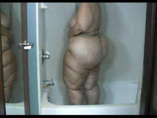 mature obese brunette takes a shower and washes
