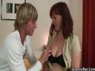 brunette granny receives this younger lad to blow