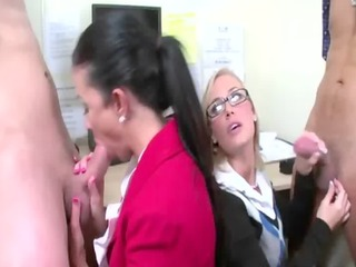 black haired and blond blow knobs in the office