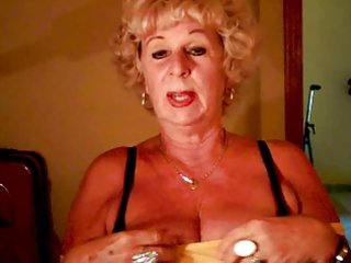 granny andrea shows her moist tits