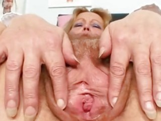 bawdy mature lady toys her hair