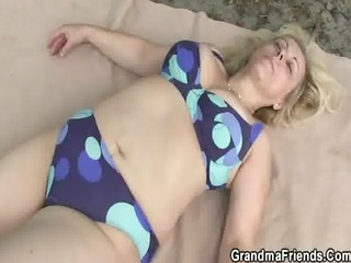 old whore takes rods outdoors