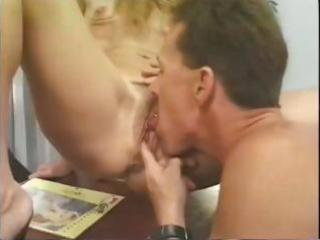 blond older secretary bangs her boss on the desk