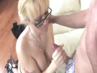 aged whore is giving a handjob