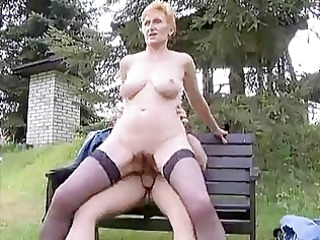 tall redhead german aged fucked in the grass