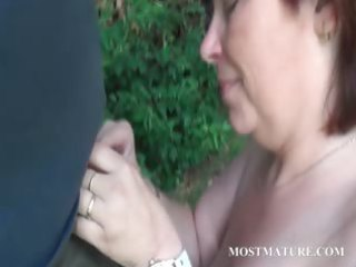 naked mom blows hard cock outdoor