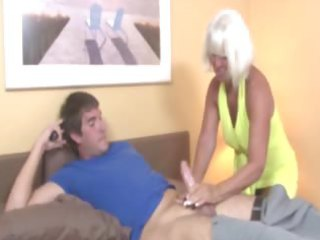 granny welcomes chap wtih a tugjob