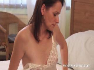slender mature playing with sexy assets