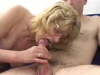 golden-haired granny in glasses fucks dude
