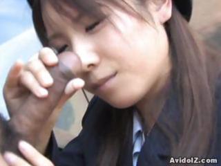 japanese momo aizawa gives an outdoor