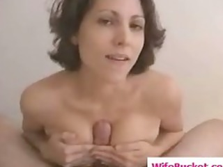 breasty wife gives a titjob
