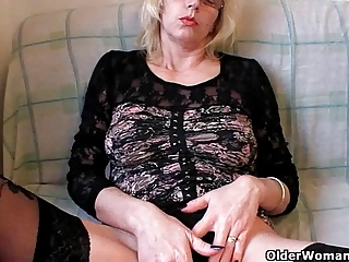 lustful grandma in stockings fists her bushy