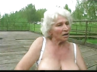 granny norma outdoors with large toys and a