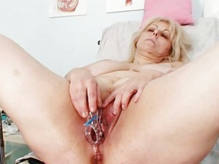 sexually excited blond mature lady at gyno exam