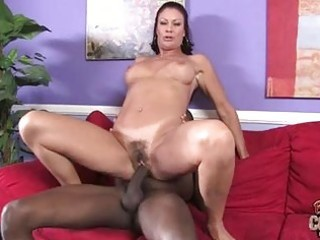 Tanned mature brunette gets huge black cock up