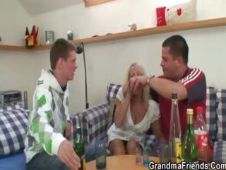 partying chaps lure granny into three-some