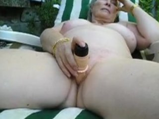 older playing outside with toy and cums
