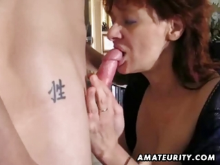 amateur redhead milf sucks and copulates a young